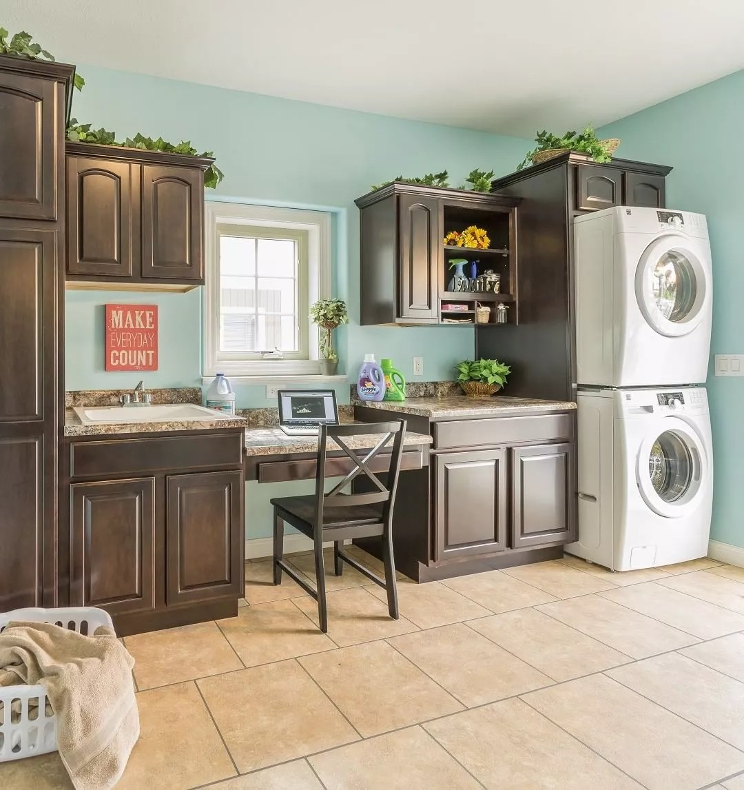 combination room with built in desk and laundry room photo by Instagram user @rochester_homes_inc