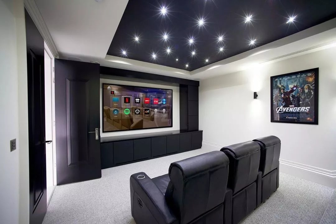 home theater with limited seating and large tv on the wall photo by Instagram user @rndtechnology