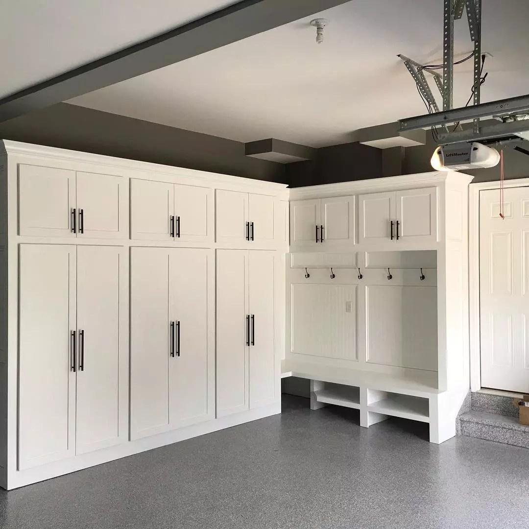 Interior of garage with built-in storage. Photo by Instagram user @aminteriorwood