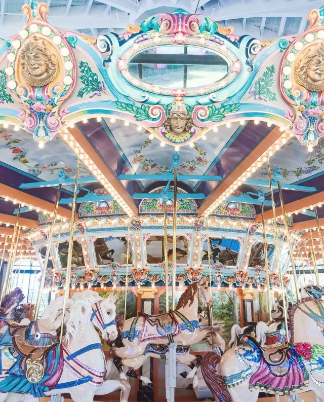 A magical light pink and blue merry-go-round with horses. Photo by Instagram user @alice.kerley