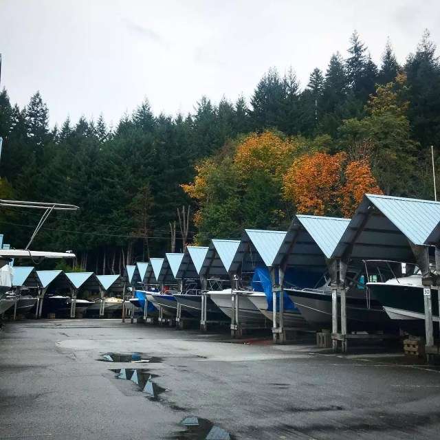 boats stored at an outdoor storage facility with coverings photo by Instagram user @notredawn