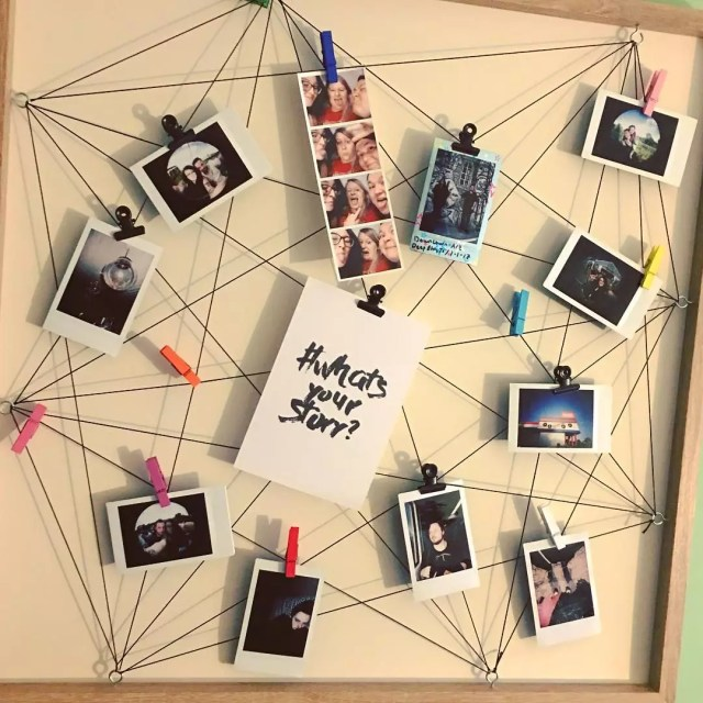 photos hung up on the wall using clothespins and string photo by Instagram user @chrissyboxful