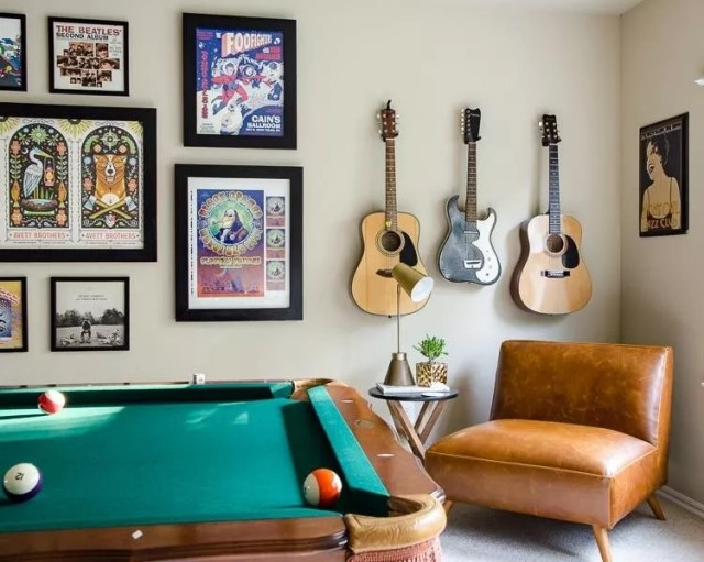Room with pool table and guitars on wall. Photo by Instagram user @mediavine