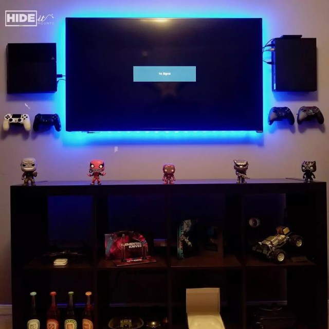 Wall mounted game systems. Photo by Instagram user @hideitmounts