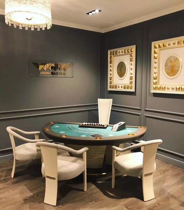 Poker table in grey game room. Photo by Instagram user @vismaradesignitaly