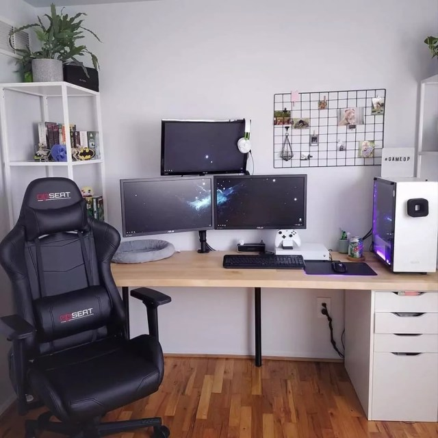 Gaming chair with computer desk. Photo by Instagram user @opseatgaming