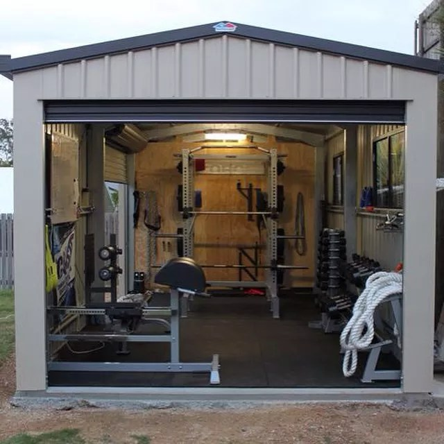 Outdoor shed transformed into gym with weightlifting equipment. Photo by Instagram user @panther_apparel