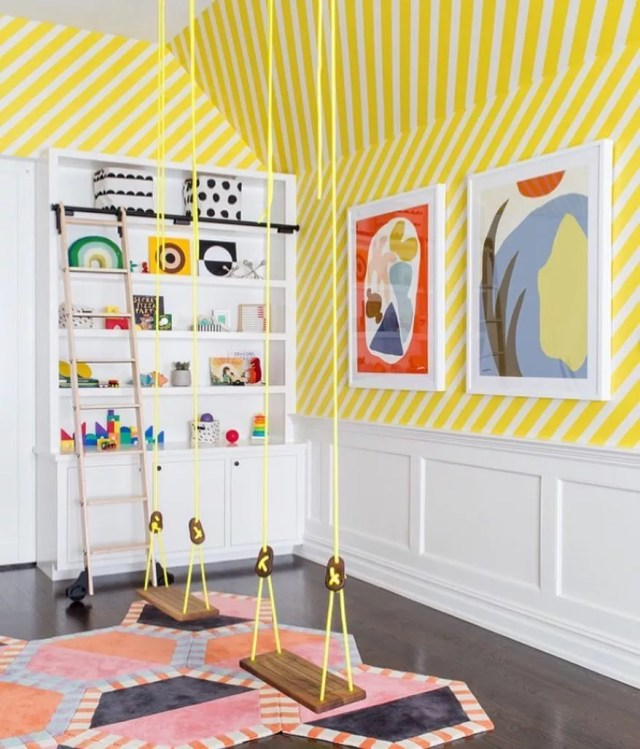 Yellow swings hanging from ceiling in yellow striped room. Photo by Instagram user @interiorjoy