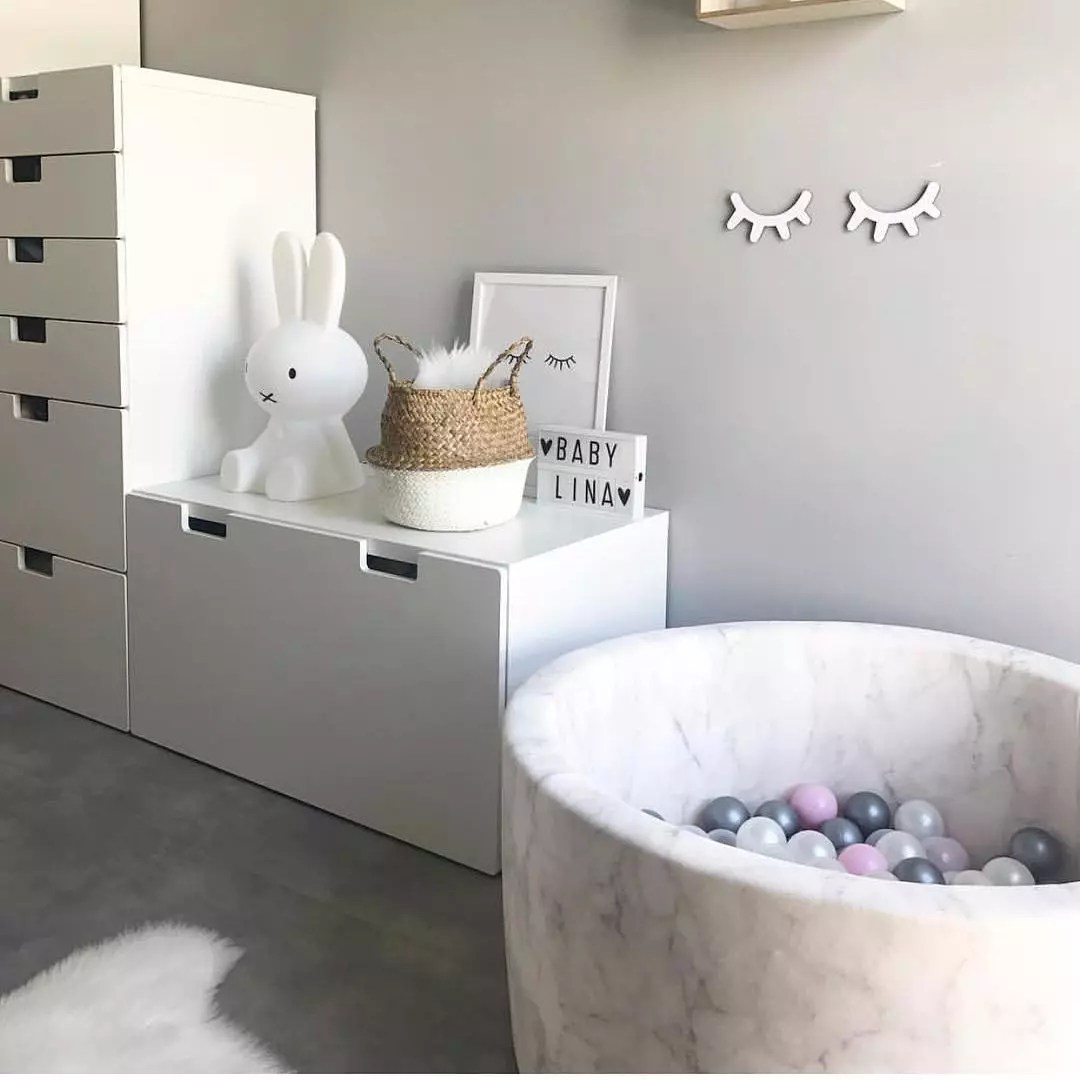 Grey kid room with marble-patterned ball pit. Photo by Instagram user @daisies_dinosaurs_decor