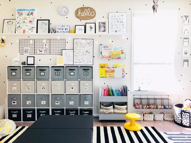 Grey, white, and black storage cube in room with kids art. Photo by Instagram user @elizabethcancaan