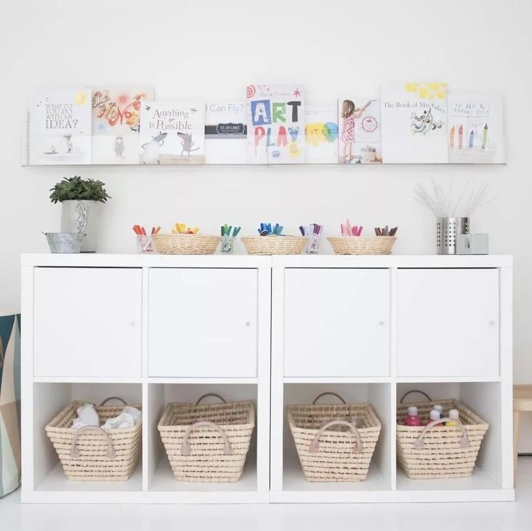White cabinets with wicker baskets underneath. Photo by Instagram user @thetot