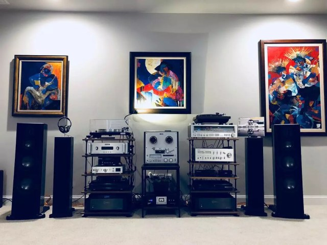 home stereo equipment sitting on top of sturdy shelves photo by Instagram user @ervinr