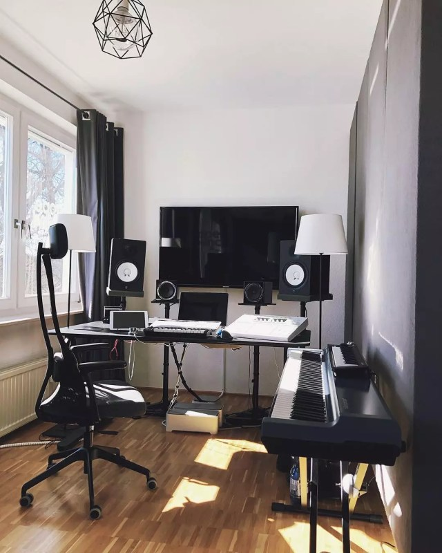 Home music studio with computer on wall and dark soundproof dividers photo by Instagram user @dopesoundstudio