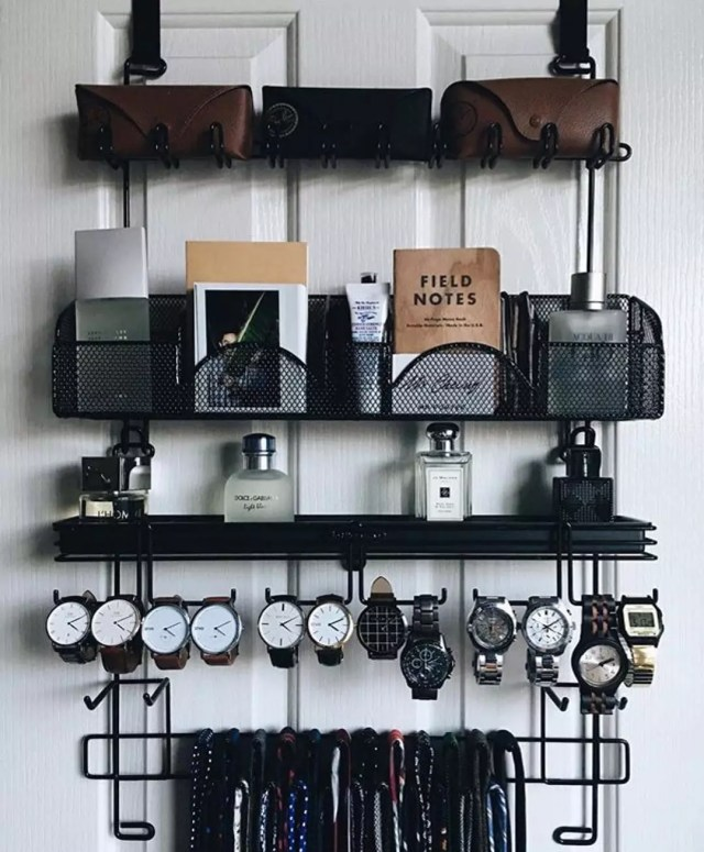 Storage rack on backside of door holding men's accessories. Photo by Instagram user @prismclothingco