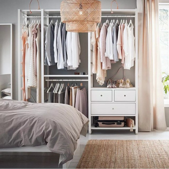 Standalone wardrobe closet in studio apartment. Photo by Instagram user @organizational.logistics