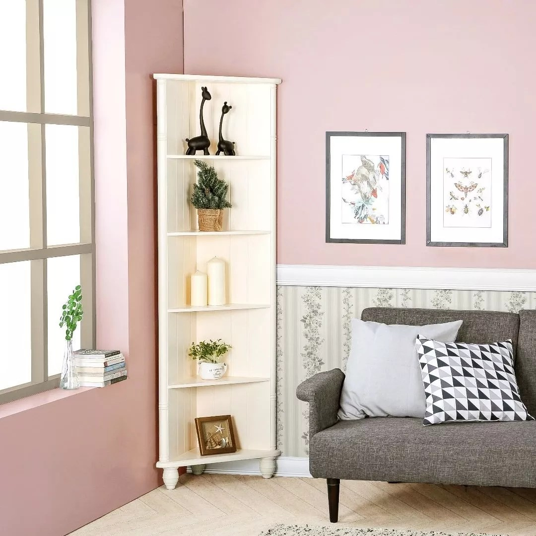 Pink living room with white corner shelves. Photo by Instagram user @ifurnholic
