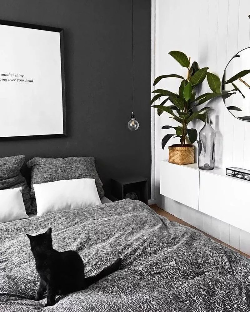 Monochrome bedroom with floating shelves on wall. Photo by Instagram user @neubauarquiteturadesign