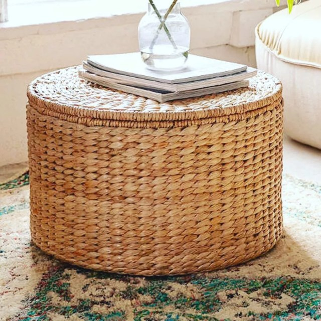 Wicker storage ottoman in living room. Photo by Instagram user @aliewaldmanhome