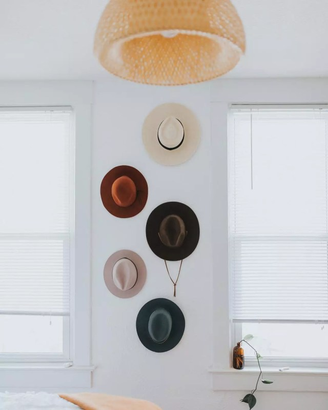 Hipster hats hanging on wall in bedroom. Photo by Instagram user @kaleyfromkansas