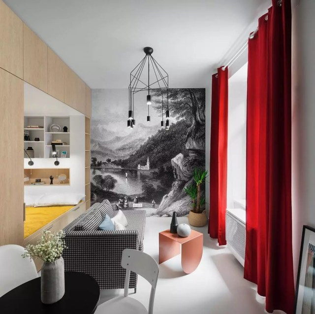small apartment with floor to ceiling mural on an accent wall photo by Instagram user @reklektik