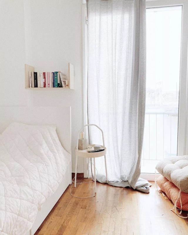 small apartment utilizing long curtains to make the room feel larger photo by Instagram user @josephinemrg