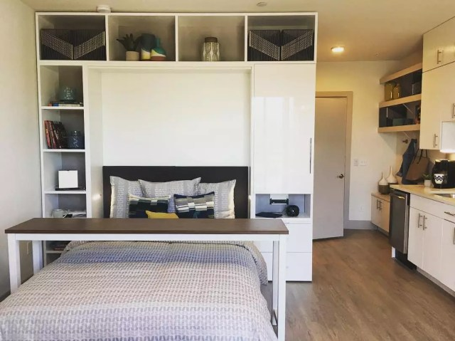 Murphy bed built into small apartment with storage around it photo by Instagram user @atxdreamdigs