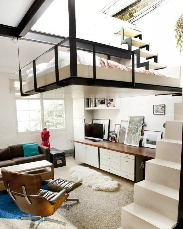 loft bed suspended from the ceiling with steps up to it photo by Instagram user @designwanted