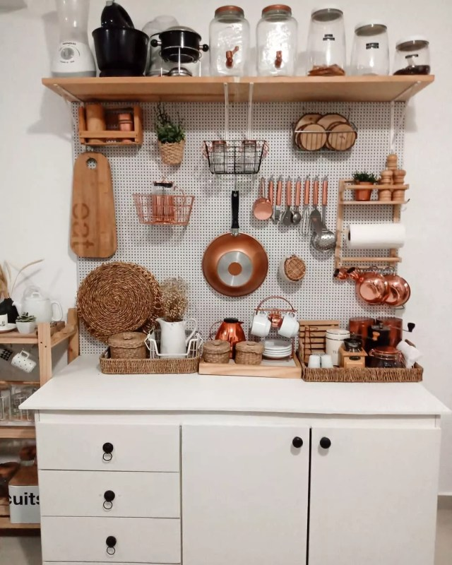 kitchen storage area using pegboard for vertical storage photo by Instagram user @casa296dachris