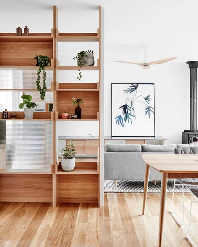 studio apartment space that uses semi-open furniture to separate rooms photo by Instagram user @hunkerhome