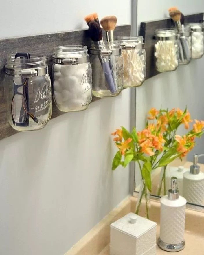Mason Jars Hanging on Bathroom Wall Holding Toiletries. Photo by Instagram user @household_plastic