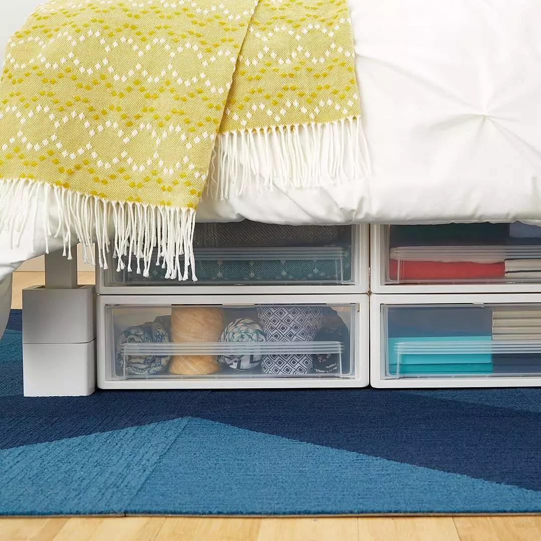 Storage containers under bed. Photo by Instagram user @thecontainerstore