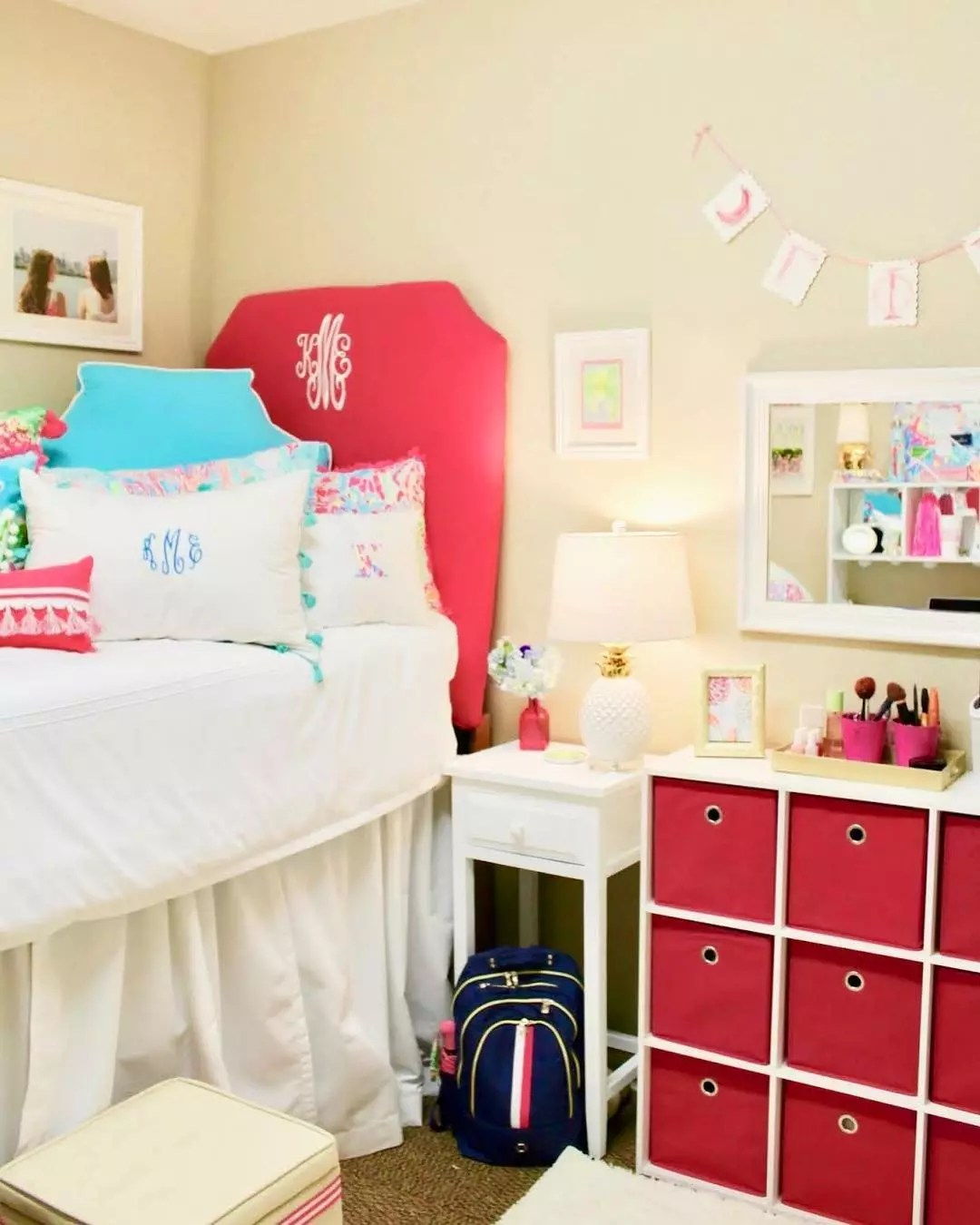 College Dorm Room with Red Cube Storage Alongside Bed. Photo by Instagram user @letsgetpreppy_