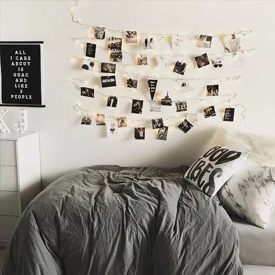 College Dorm Room with Photos Hanging from Strings on Wall. Photo by Instagram user @creativedorm