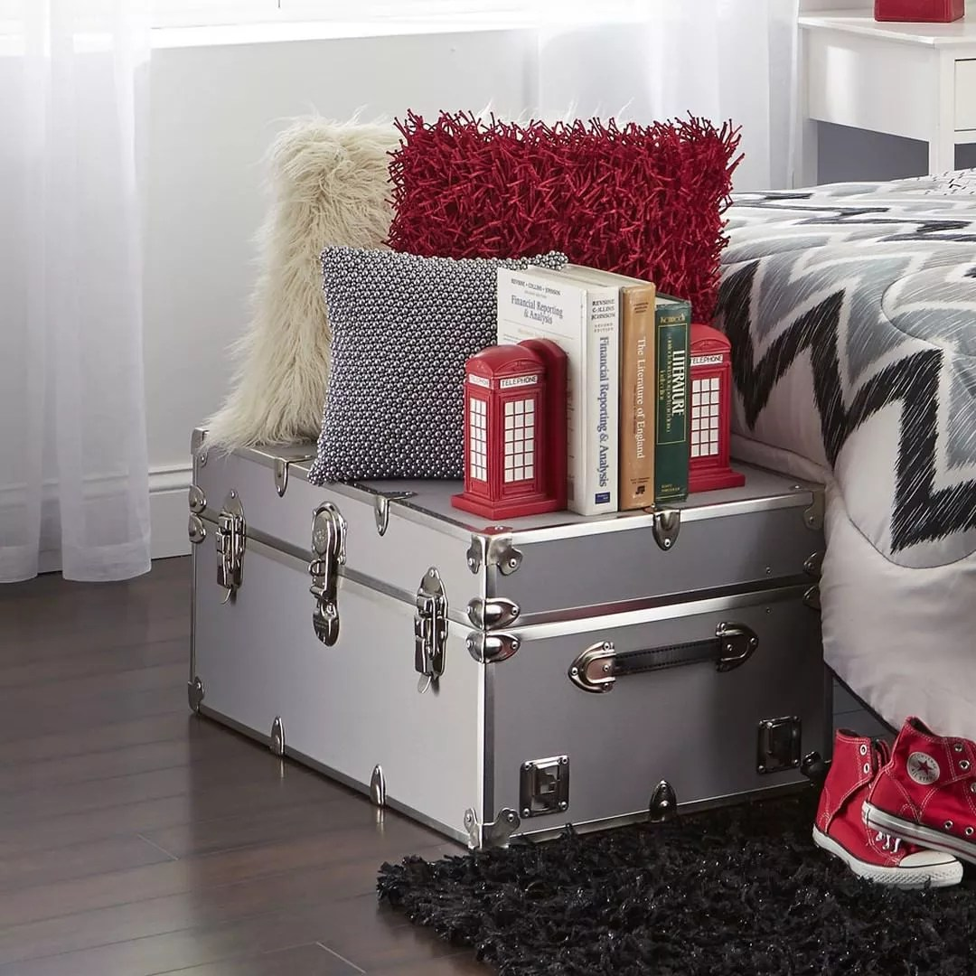 Stylish Storage Trunk with Pillows and Books on Top. Photo by Instagram user @ocmcollegelife