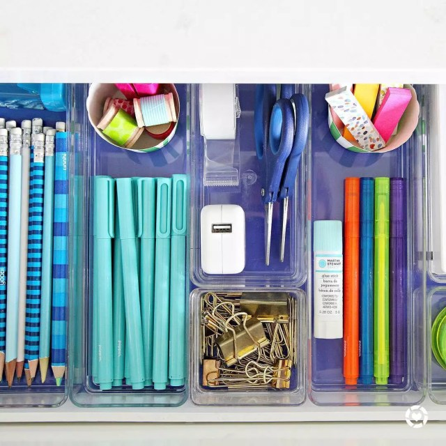 School supplies organized in clear plastic containers for desk. Photo by Instagram user @iheartorganizing