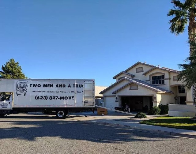 Professional Moving Truck in Front of a House. Photo by Instagram user @twomenandatruck