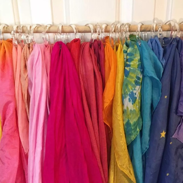 Colorful scarves hanging with shower curtain rings. Photo by Instagram user @pepperandpine