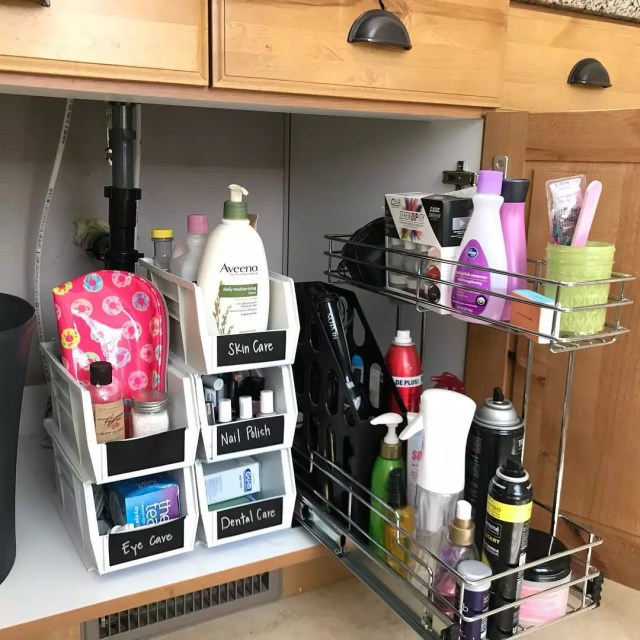 Interior cabinet with stacked bins and rolling organizers. Photo by Instagram user @harmonyorganized