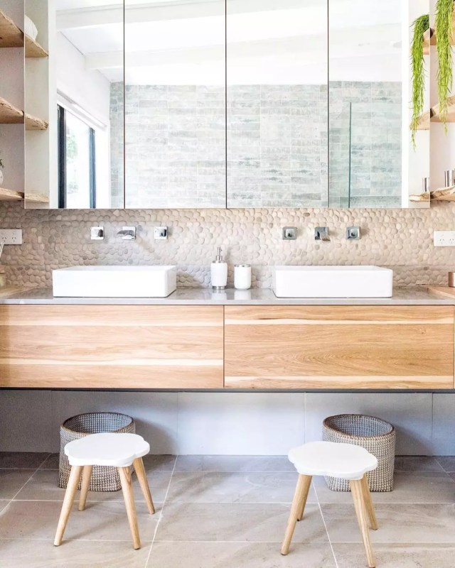 his and hers sinks on a floating vanity and stools photo by Instagram user @tlcinteriors