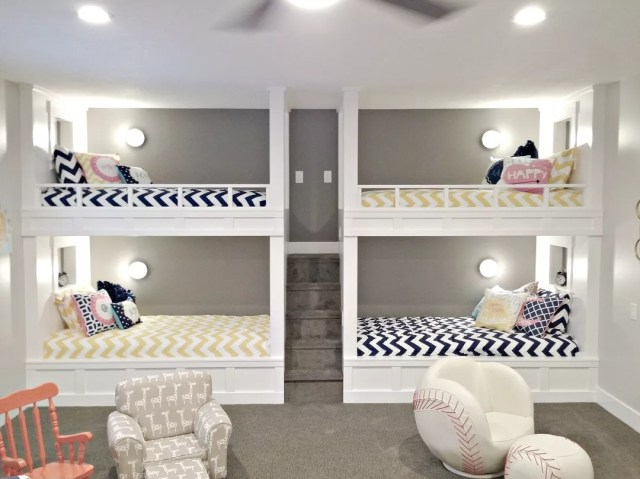 basement bedroom with four bunk beds and small childrens chairs nearby photo by Instagram user @remodelaholic
