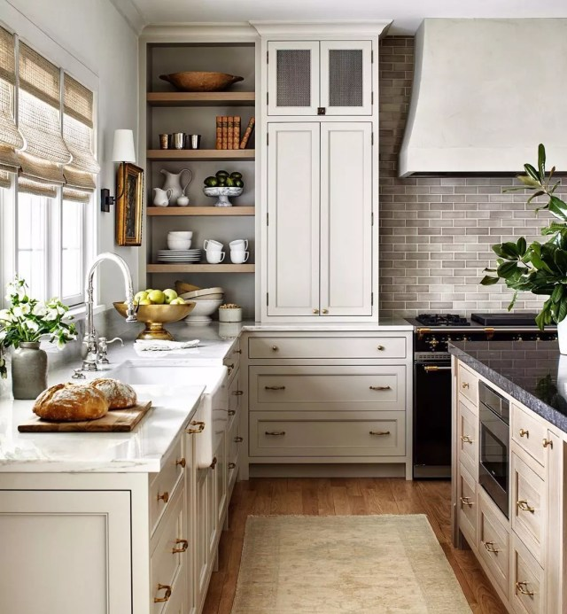 Modern farmhouse-style kitchen with brass hardware. Photo by Instagram user @stacyzaringoldberg