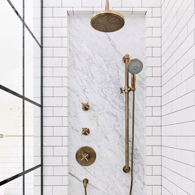 Shower with brass fixtures. Photo by Instagram user @in.house.design