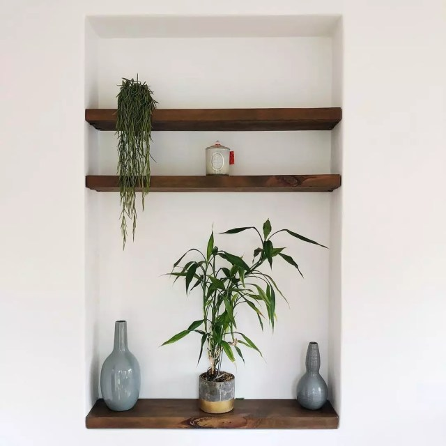 Recessed shelves with minimalist decor. Photo by Instagram user @cassandra_lawless