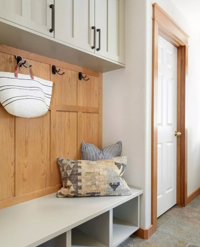 Mudroom with hooks for storage. Photo by Instagram user @amypearsondesign