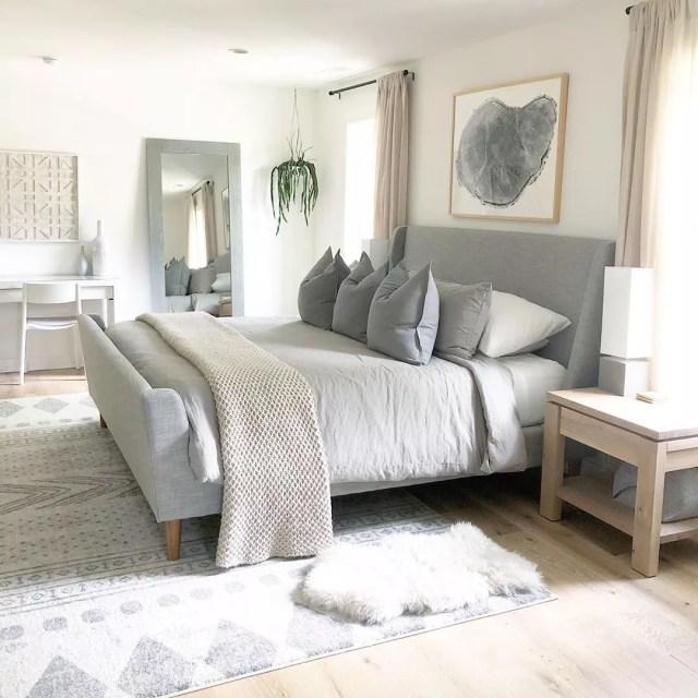 Neutral minimalist bedroom with mirror. Photo by Instagram user @thehouseonhillsidelane
