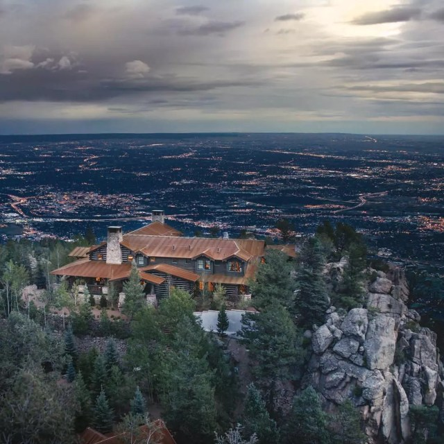 overlooking colorado springs on cloudy day with large home in the foreground photo by Instagram user @csna_architects