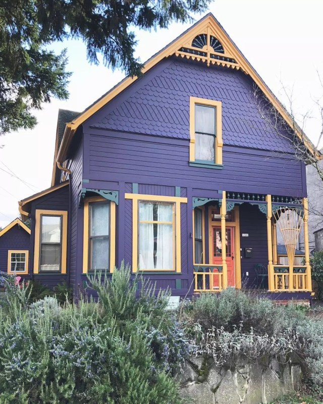 Front of single-family home painted purple with yellow trim Photo by Instagram user @housesofportland