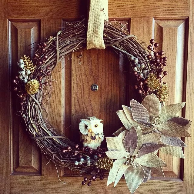 Homemade Wreath Made out of Sticks Hanging on Front Door. Photo by Instagram user @momendeavors