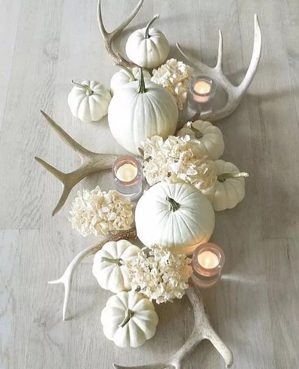 Homemade Dinner Table Decor Made From Pumpkins, Candles, and Animal Horns. Photo by Instagram user @woodsidehomescentralcal