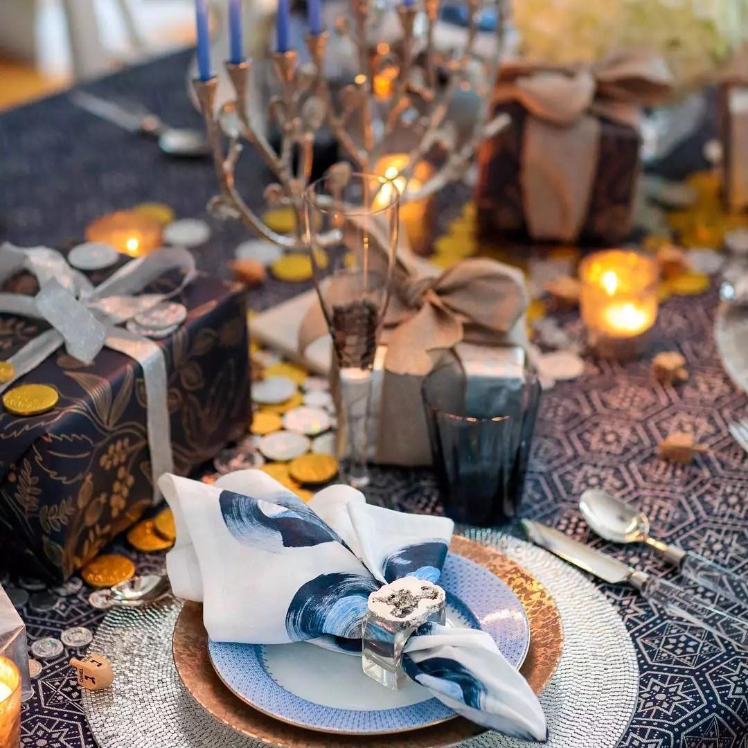 Table Set with Elaborate Utinsels for Hanukkah Dinner. Photo by Instagram user @kimseybert